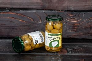 Green pitted olives in a jar 180gr