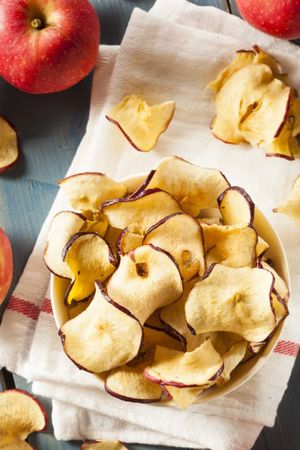 50g of premium baked apple chips. 100% natural. 0% added sugar
